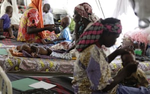Women feed their malnourished children at a feeding centre run by Doctors Without Borders in Maiduguri, Nigeria