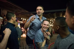 At a restaurant, Recruit Saballos leans on Recruit Giusti as the group decides where to spend their Friday night. A tight-knit class of 31, the men will share a close bond throughout their career
