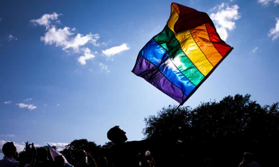 People parade wave a rainbow coloured flag during WorldPride in Copenhagen, Denmark.