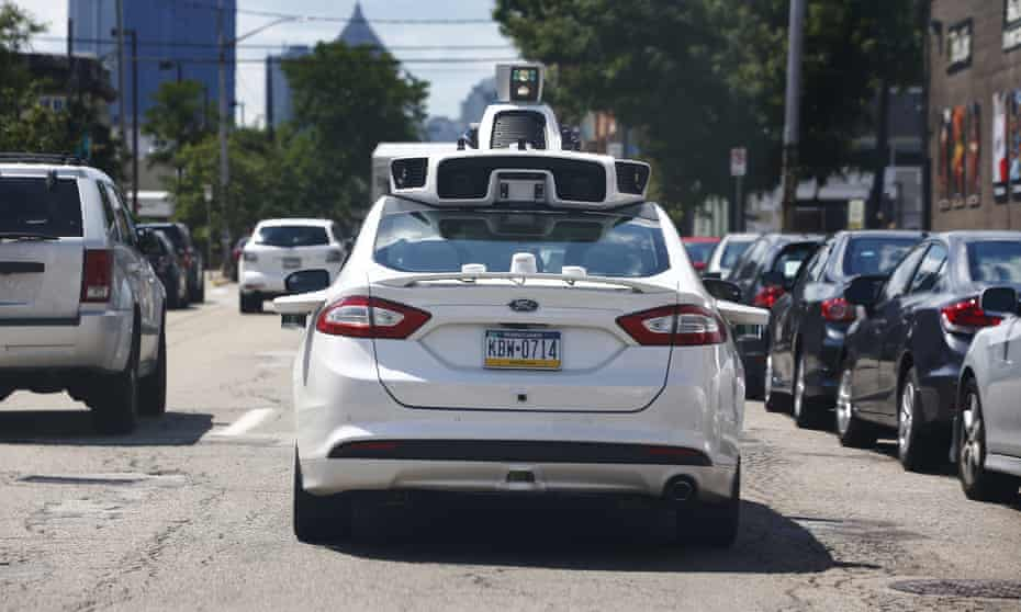 A self-driving Ford Fusion hybrid car is test driven in Pittsburgh. Uber said that passengers in Pittsburgh will be able to summon rides in self-driving cars in the next several weeks.
