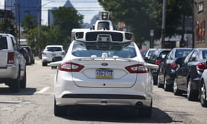 A self-driving Ford Fusion hybrid car is test-driven in Pittsburgh.