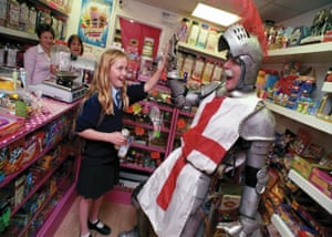 Saint George of England greets a customer at Auntie Pam's sweet shop, Bury St Edmunds, Suffolk 2014