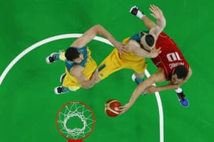 Serbia's Nikola Kalinc attempts a shot despite the attentions of Australia's Aron Baynes.