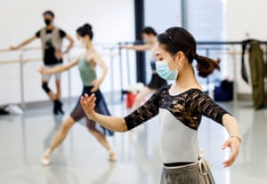 Dancers rehearse in masks
