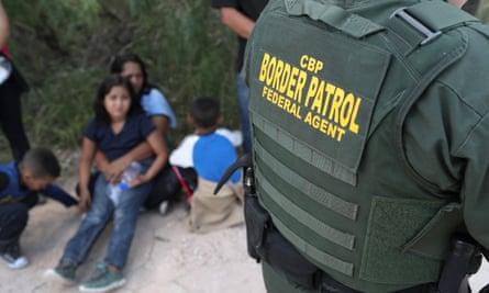 US Border Patrol agents take a family into custody near McAllen, Texas.