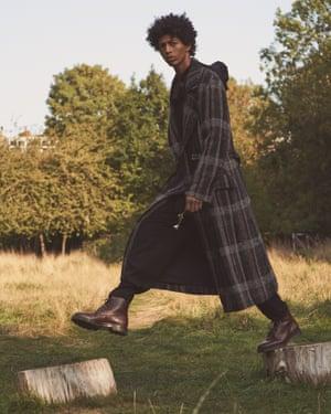 Coat, shirt, and trousers, all yohjiyamamoto.com. Hat, asos.com. Boots, apc.fr