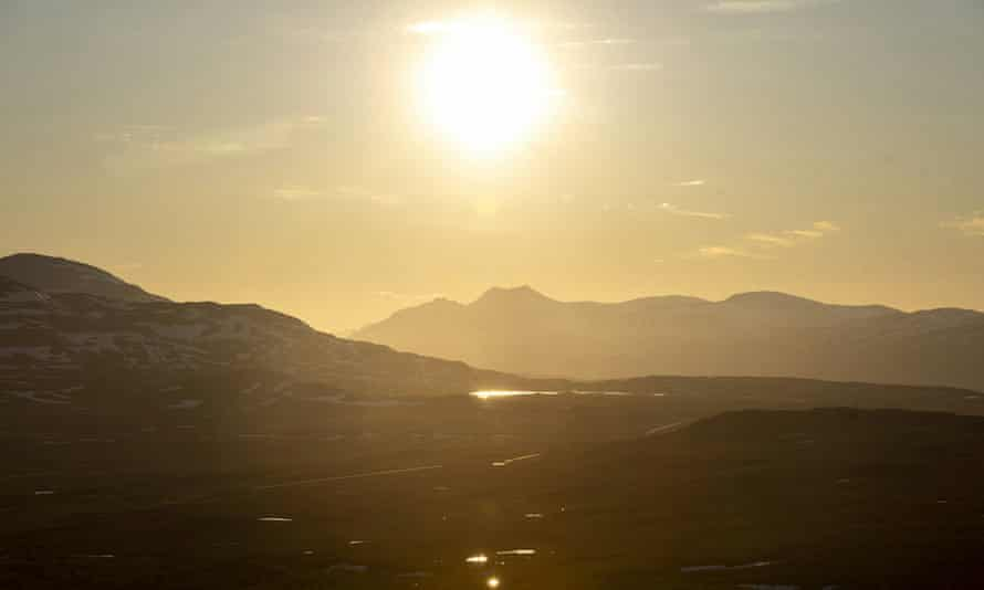 The midnight sun shines at the border area between Finland and Norway in Kilpisjarvi, Enontekio, Finland, on June 22, 2020. Finland's national meteorological institute has registered its hottest temperature for June since records began in 1844.