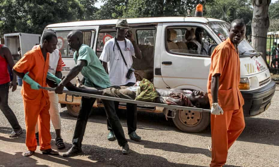 A wounded man is carried into the hospital in Bangui