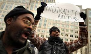 Demonstrators outside the FCC building in Washington, DC.
