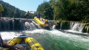 inflatable kayak comes over the rapids in Croatia