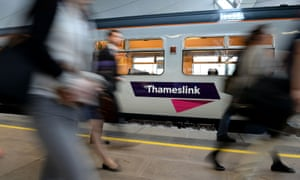Commuters passing a Thameslink train. Customers across networks have experienced delays and cancellations following new timetables on 20 May.