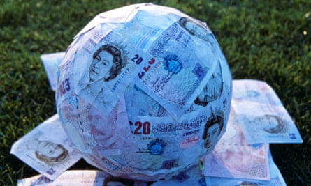 Football wrapped in cash