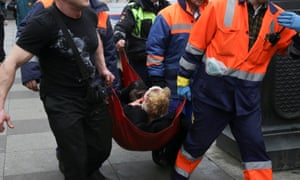 An injured person is helped by emergency services