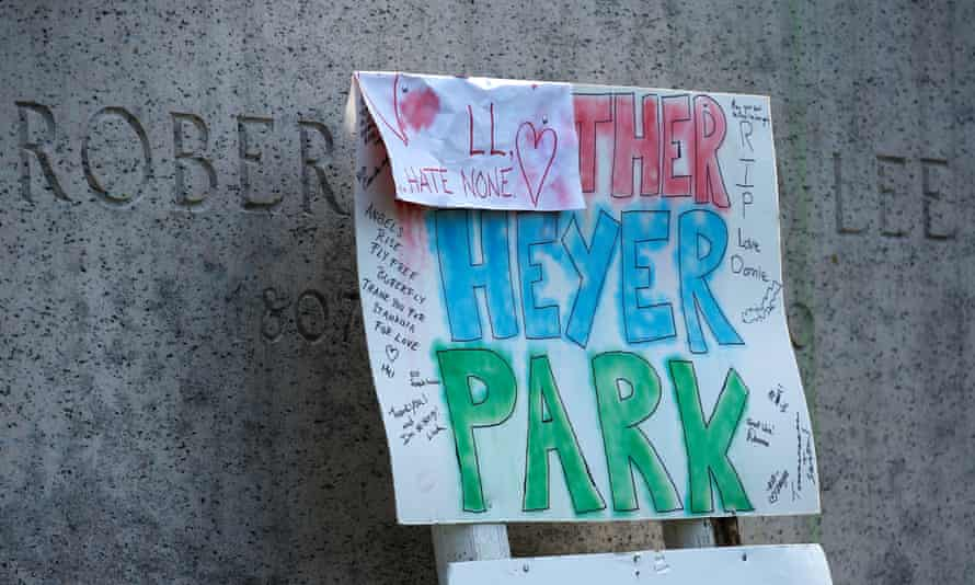 A sign on the statue of Robert E Lee calls for the park to be renamed for Heather Heyer, who was killed at the far-right rally, in Charlottesville, Virginia.