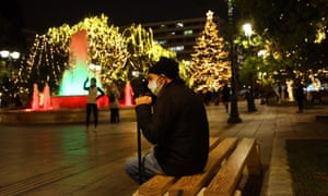 People walk at central Syntagma square that is decorated for Christmas in Athens, Greece, 15 December 2020.