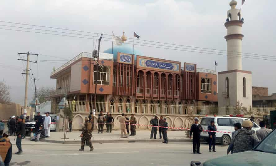 Afghan security forces keep watch in front of the mosque in Kabul after the bomb attack