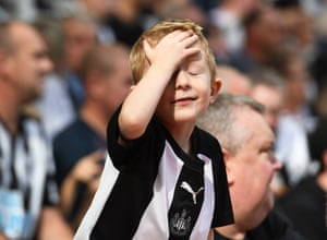 A young Newcastle United fan looking rather exasperated. His side also fell behind to an early goal from Watford's Will Hughes but drew level courtesy of Fabian Schär's effort just before the break. The game ending 1-1 with Watford collecting their first point of the season.