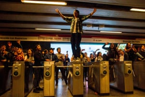 Students demonstrate at Los Héroes metro station in Santiago