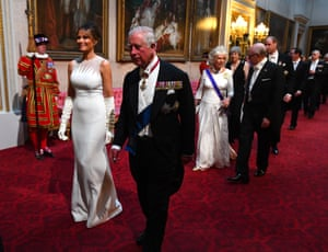Prince of Wales accompanies Melania Trump through the East Gallery to the Banquet