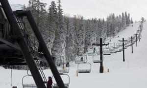 Snow-generating cannons sit alongside a ski lift at Arizona Snowbowl.