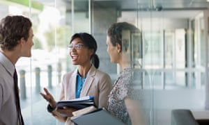 Young woman talking to colleagues