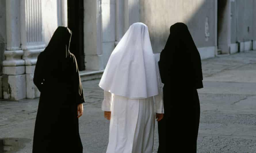 three nuns in venice viewed from behind
