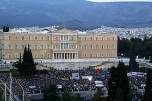 Supporters of a NO vote in the upcoming referendum gather during a rally at Syntagma square in Athens, Monday, June 29, 2015. Anxious Greek pensioners swarmed closed bank branches and long lines snaked at ATMs as Greeks endured the first day of serious controls on their daily economic lives ahead of a July 5 referendum that could determine whether the country has to ditch the euro currency and return to the drachma. (AP Photo/Petros Karadjias)