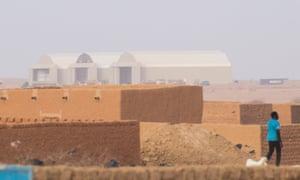 Three giant white hangars of Airbase 201,