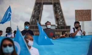 Members of the Uighur community and supporters demonstrate near the Eiffel Tower in Paris in 2020.
