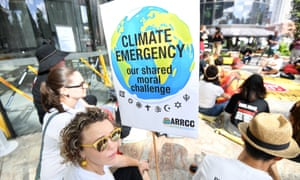 Anti Adani coal mine protestors engage in a sit-in protest outside the Queensland government headquarters in Brisbane, 12 December 2018.