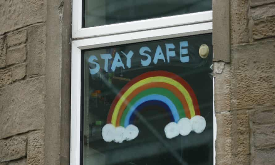 A handmade rainbow poster with 'Stay safe' written on it in the window of a flat in Dundee