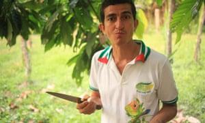 Servio Pachard Vera tasting a fresh cacao pod at Finca Sarita, a remote farm in Ecuador