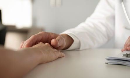 A man touching a women's hand