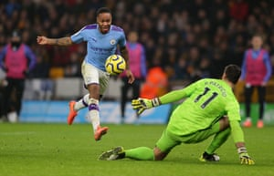 Raheem Sterling lifts the ball over Rui Patricio.