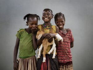 Three girls with a kid goat