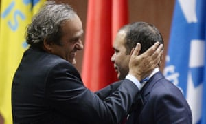 Prince Ali bin al-Hussein, right, is embraced by Uefa President Michel Platini, left, after al-Hussein announced his withdrawal in the Fifa president election.