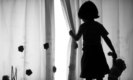 Silhouette of little girl with doll