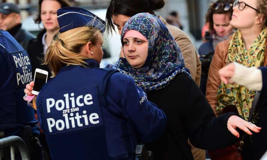 Security checks at a vigil for the Paris attacks in Molenbeek, Belgium
