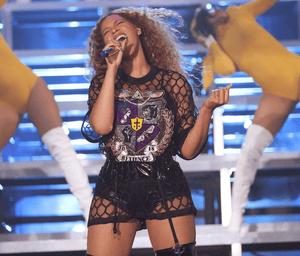 Beyoncé wearing her T-shirt with 'Beyoncé-themed' crest.