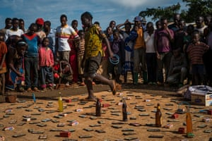 A gambling game at a market on the edge of the camp