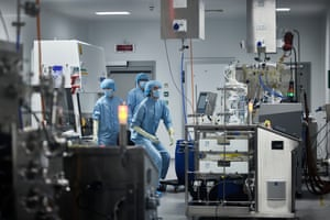 Bio-technologists at Oxford Biomedica at work with the 1,000-litre bioreactor in a vector production suite at their facility in Oxford, England.