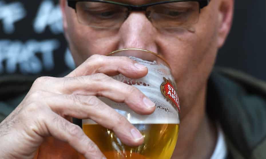 A man drinking in a pub