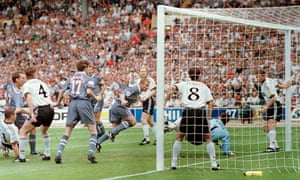 Alan Shearer (centre) scores the first goal during the Euro 96 semi-final between Germany and England .