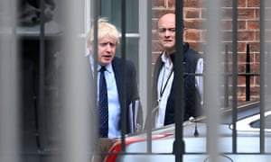 Boris Johnson and Dominic Cummings leave from the rear of Downing Street