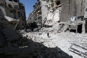A man walks through the rubble following air strikes by government forces on the eastern Shaar neighbourhood of the northern Syrian city of Aleppo in March 2015.