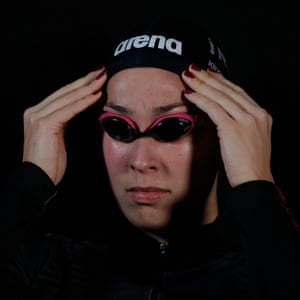 Ranomi Kromowidjojo of Holland and Team Iron adjusts her goggles before competing in the women's 100m butterfly.