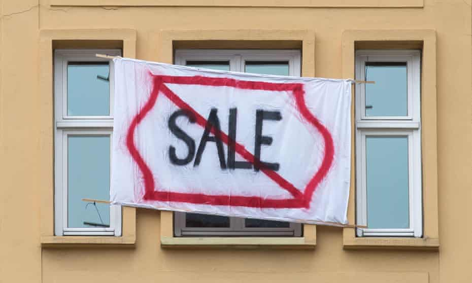 A sign in Karl-Marx-Allee protesting against the sale of apartments to Deutsche Wohnen.