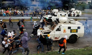 Demonstrators clash with riot police during a May Day rally against Maduro. At least 29 people have died in the unrest of the past month and hundreds have been injured.