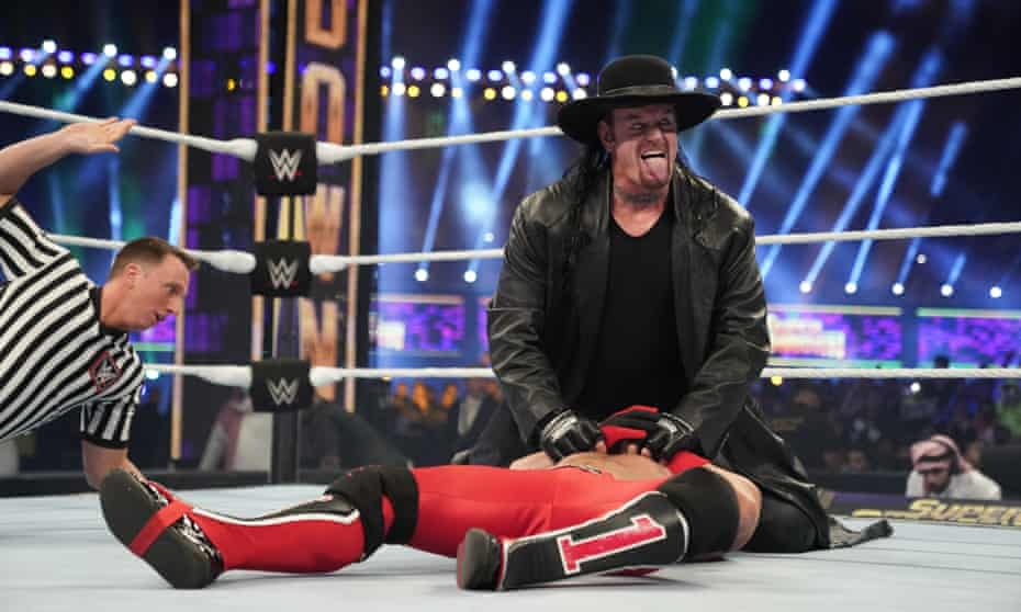 Lord of the ring … The Undertaker pins AJ Styles at 2020's Super ShowDown.