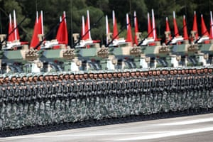 Soldiers react as Chinese President Xi inspects troops at the Shek Kong military base.
